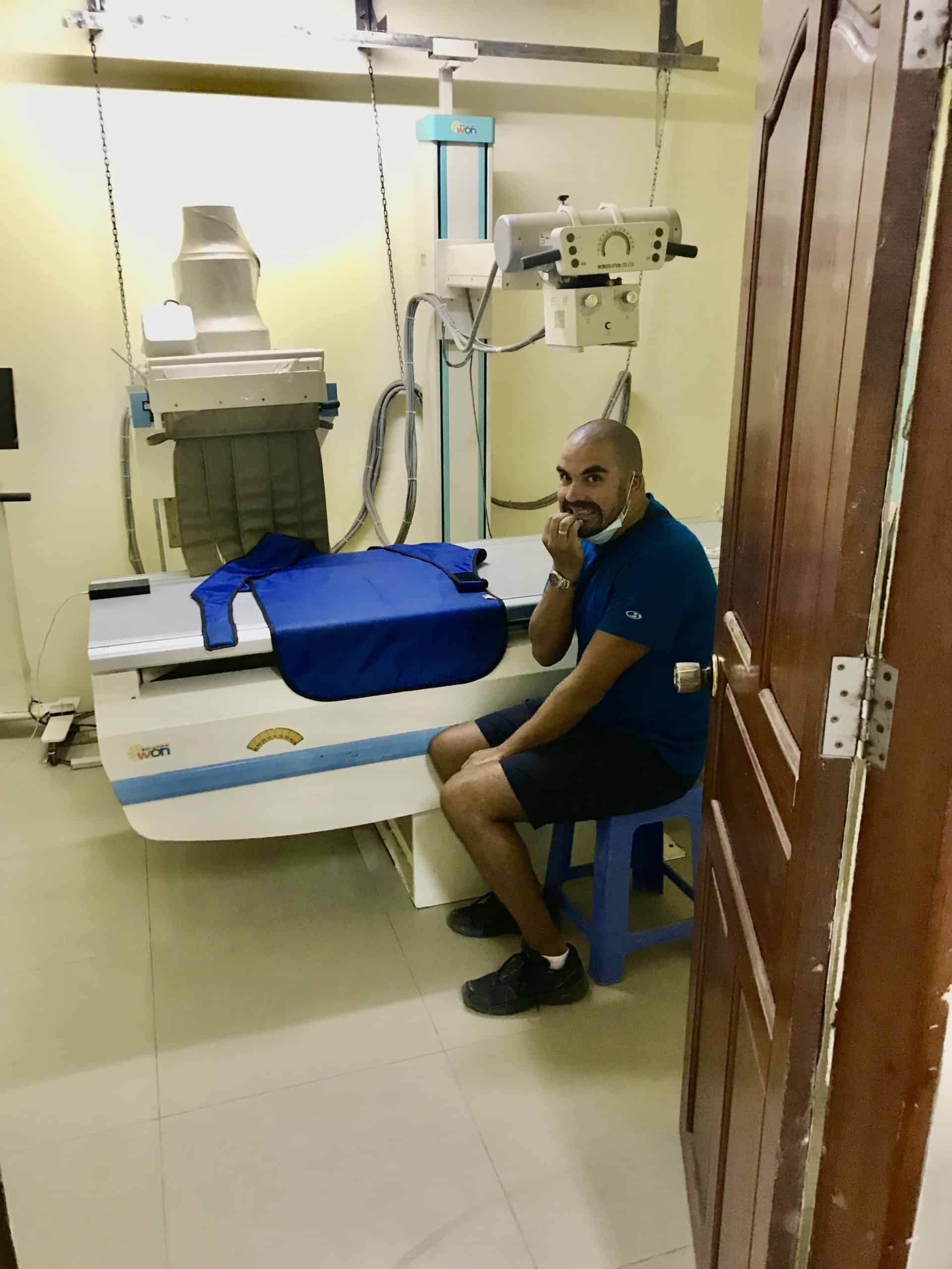 Omer waiting for an x-ray at a hospital in Cambodia